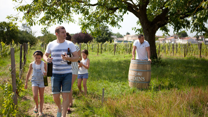 family visiting vineyards